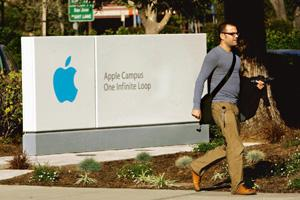 'i-war': A man walks on the Apple Inc. campus in Cupertino, California. The company is fighting several trademark applications. Robert Galbraith / Reuters
