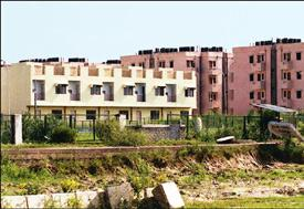 Homes for masses: Janta flats at Narela in Delhi. Developers are required to reserve a part of their projects for low-income groups, but there still aren't enough 300-500 sq. ft flats. This affects ho