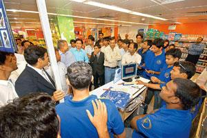 Playing to a new field: Members of the Rajasthan Royals team, winners of IPL's season 1, at a Reliance Fresh outlet in Jaipur. The players were promoting the team's fan club and encouraging locals to