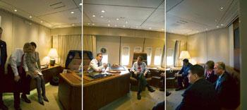 Reassuring: A three-picture combo shows Obama with Ohio legislators aboard Air Force One on Friday. Stephen Crowley / NYT