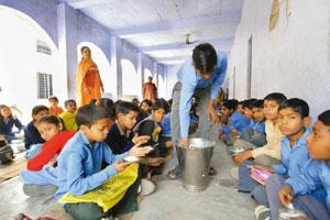 Slow pace: A government school at Faridabad in Haryana. The Mid-day Meal Scheme, which the UPA claims benefited 117.4 million children in 2008-09, saw a row between the Planning Commission and ministe