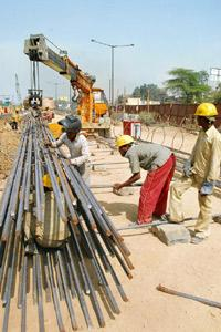 Coming along: A file photo of a road being built in New Delhi. NHAI already makes advance payments to help contractors purchase materials. Raj Kumar / Mint