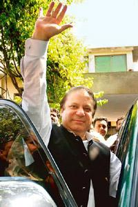 Protest wave: Nawaz Sharif defies house arrest in Lahore on Sunday. AP