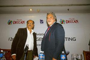 New flight path: A file photo of UB Group chief Vijay Mallya and Deccan Aviation chairman G.R. Gopinath. When Mallya had bought Air Deccan in Dec 2007, he hoped to realize his ambition to fly oversea