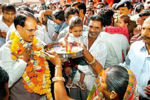 For the people? Madhya Pradesh chief minister Shivraj Singh Chouhan being welcomed by supporters while campaigning in Bhopal on Sunday for the coming state assembly elections. Chouhan is hoping that t