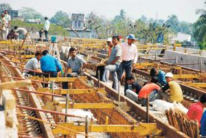 Stalled: A file photo of workers at Kolkata Metro extension site. The project has been affected because the state government had not transferred the entire land and encroachers had occupied a part of