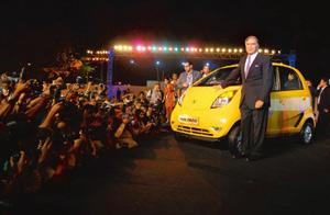Big splash: Chairman Ratan Tata with the newly launched Nano at the Parsi Gymkhana in Mumbai, where he announced that the car would be priced at Rs1 lakh ex-factory.