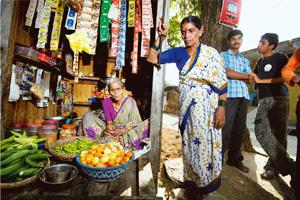 On demand: Koyada Somalakshmi (left), a retailer in Nellutla village, Jangaon, says instead of asking for just shampoo or oil, customers are increasingly asking for specific products. Harikrishna Katr
