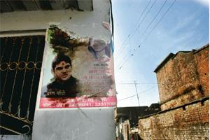 Political divide: A defaced poster of Bharatiya Janata Party's Varun Gandhi in a Muslim-dominated area of Pilibhit in Uttar Pradesh. Ramesh Pathania / Mint