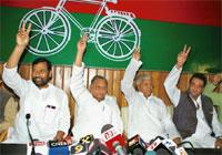 Joint forces: (L-R) LJP chief Ram Vilas Paswan, SP chief Mulayam Singh Yadav and RJD chief Lalu Prasad with SP national general secretary Sanjay Dutt at the SP office in Lucknow on Friday. Ajay Kumar