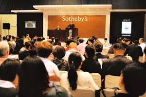 Nascent market: An auctioneer takes bids during the Sotheby's wine auction at the Hong Kong Convention Exhibition Center on Saturday. Sotheby's Hong Kong via Bloomberg