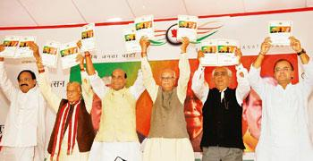 Popular agenda: (from left) Bharatiya Janata Party leaders Murli Manohar Joshi, Rajnath Singh, L.K. Advani and Jaswant Singh at the release of the party's election manifesto in New Delhi on Friday. Ra