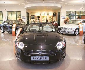 Costly ride: New Jaguar cars on sale at a dealership in Cambridge, the UK. Tata Motors will use funds raised through the NCD issue to repay part of the bridge loan it took to buy Jaguar and Land Rover