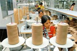 Boom time: Exporters such as Bangalore-based Gokaldas Exports say they are becoming more competitive after the rupee fell 20% in the past year to 50.195 per dollar, while the yuan rose 2.4%. Jagadeesh