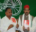 Samajwadi Party chief Mulayam Singh Yadav and party general secretary Amar Singh release manifesto in Lucknow on Saturday. AFP photo