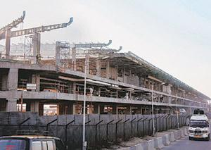 Test case? A file photo of Delhi airport's new terminal being built by Delhi International Airport Ltd. The airport's Terminal 3 is designed to have around 20,000 sq. m of retailing space and is expec
