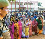 Beginner's guide: A file photo of people queuing up outside a polling booth in Tripura. The voter awareness campaigns are focusing largely on the 43 million new voters added across India in the last f