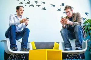 Streaming messages: Evan Williams (left) and Biz Stone, Twitter's founders, at the company's headquarters in San Francisco. Twitter can be a surprisingly useful problem-solving Web service. Companies