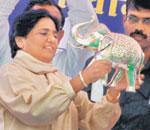 Jumbo moment: Mayawati with a silver elephant gifted by party workers. PTI