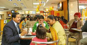 Happy meals: A family enjoying a snack at a McDonald's outlet in Janpath, New Delhi. Ramesh Pathania / Mint