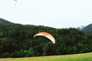 In flight: After a week of skiing, campers at Les Elfes spend a week learning other adventure sports such as paragliding. Les Elfes Proprietary