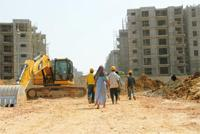 In a spot: The construction site of Commonwealth Games Village 2010 in New Delhi. Given the realty slump, Emaar MGF has been finding it difficult to attract buyers for its apartments. Rajkumar / Mint