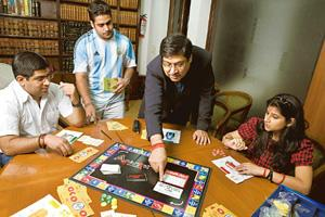 Legal game: Lawyer Pravin Anand plays Anaryst with his family. Anand expects the board game to sell for around Rs500. Madhu Kapparath / Mint