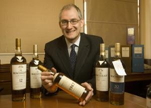 Ken Grier, director of Malts, The Edrington Group, shows a limited edition Macallan whisky bottled in 1947.