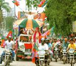 On the campaign trail: A Bharatiya Janata Party bike rally in support of candidate Bijoya Chakraborty in Guwahati on 21 April. PTI