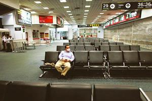 Serious repercussions: A man sits at a nearly vacant airport terminal in Mexico City. For the already struggling aviation industry, the swine flu scare could bring further pain as travel restrictions