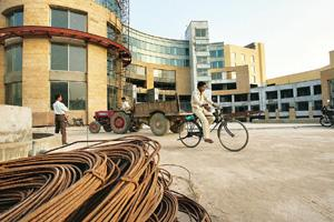 Growth suffering: Construction cables await the return of financing and workers at a mall site in Gurgaon. Ruth Fremson / The New York Times