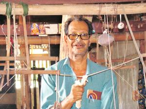 Master weaver: P. Gopinathan, who won the Padma Shri in 2007, at work. He says it is necessary to raise minimum wages substantially so that more people are attracted to this profession. Ajayan / Mint