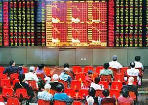 In the red: Investors monitor stock prices at an exchange in Shanghai. The Shanghai Composite dropped 1.8% to 2,579.78 points on Monday. Qilai Shen / Bloomberg