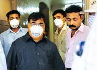 Cautious: The staff at a hospital in Pune wearing masks as two patients in an isolation ward await medical tests for swine flu. So far, no case of infection or death has been reported in India. AFP