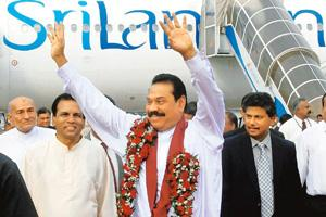 'Militarily' victorious: Sri Lankan President Mahinda Rajapakse arrives in Colombo on Sunday after a trip abroad during which he announced that the LTTE had been defeated in the 25-year civil war. Reu
