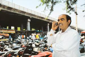 Within reach: A mobile phone user in Faridabad, Haryana. It is estimated that telephone firms across the country would spend at least $15 billion this fiscal in setting up or expanding their networks.
