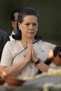 Congress party president Sonia Gandhi pays tributes to former Indian prime minister and her husband Rajiv Gandhi on his 18th death anniversary, in New Delhi. AP