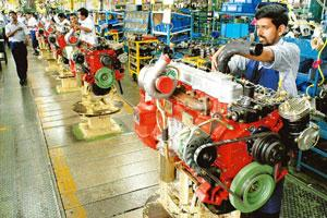 Big fall: Workers assemble engines on an Ashok Leyland Ltd production line in Hosur, Tamil Nadu. The firm saw Sri Lanka's contribution to its exports fall to 15% in 2008-09 from 50% in past years. Rog