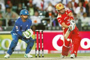 Smash hit: Bangalore Royal Challengers' Roelof van der Merwe (right) plays a shot as Deccan Chargers' Adam Gilchrist watches during their IPL final match in Johannesburg on 24 May. Mike Hutchings / Re
