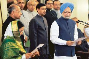Induction mode: President Pratibha Patil administers the oath to Manmohan Singh during the swearing-in of the new cabinet. Atul Yadav / PTI