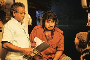 On world stage: Malayalam director Shaji N. Karun with actor Mammootty on the sets of Kutty Srank. Reliance Big Cinema