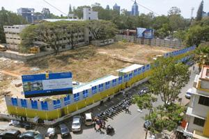 Cash crunch: A file photo of a plot of land marked for sale by Sobha Developers Ltd in a prime Bangalore locality. Hemant Mishra / Mint