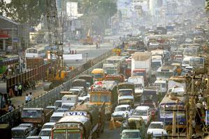Smokescreen: A file photo of New Delhi's traffic seen through a haze of pollution. The transport ministry had objected to Bureau of Energy Efficiency's proposal on standards and constituted its own p