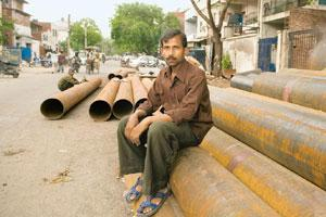Pillar to post: Raju Singh, who lost his job with Mirza International, looks for odd jobs even though there are at least five laws that oversee the provision of healthcare, accident cover and pension
