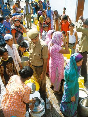 On guard: Police monitor water distribution in Bhopal to avoid a riot breaking out over the limited supply. Hindustan Times