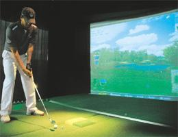 Tee party: The AboutGolf machine lets you take your pick of classic courses such as the Old Course at St Andrews in Scotland. TaylorMade