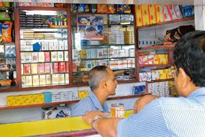 More hikes: Various brands of ITC cigarettes, among others, at a cigarette shop at Connaught Place in New Delhi. The company dominates the cigarette market in India with a strong 84% share. Rajkumar /