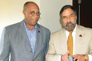 Conciliatory style: Ron Kirk (left) and Anand Sharma on Monday. Sonny Tumbelaka / AFP