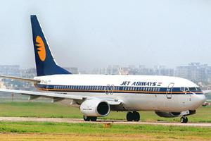 Tough times: A Jet Airways aircraft in New Delhi. The company's chairman, Naresh Goyal, says domestic carriers will lose around $2 billion if the fuel bill goes up and excess capacity remains. Ramesh