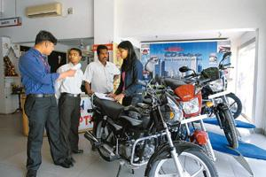 Revving up: Hero Honda Motors, which controls nearly half the two-wheeler market, sold 382,678 units locally last month.